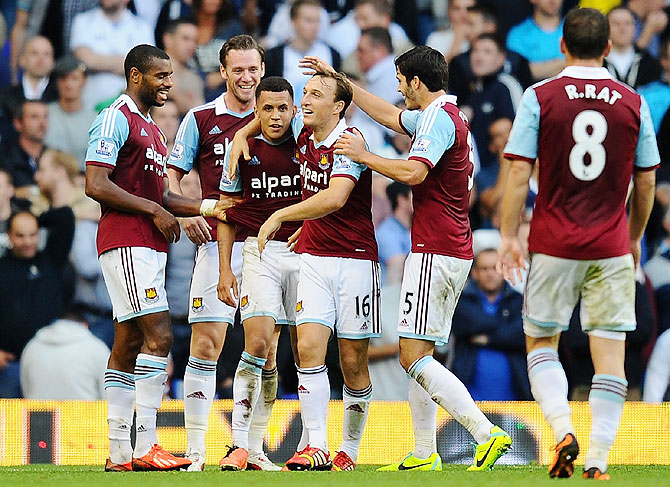 Ravel Morrison of West Ham (3rd from left) is congratulated by teammates after scoring against Tottenham Hotspur during the Barclays Premier League match at White Hart Lane in London on Sunday