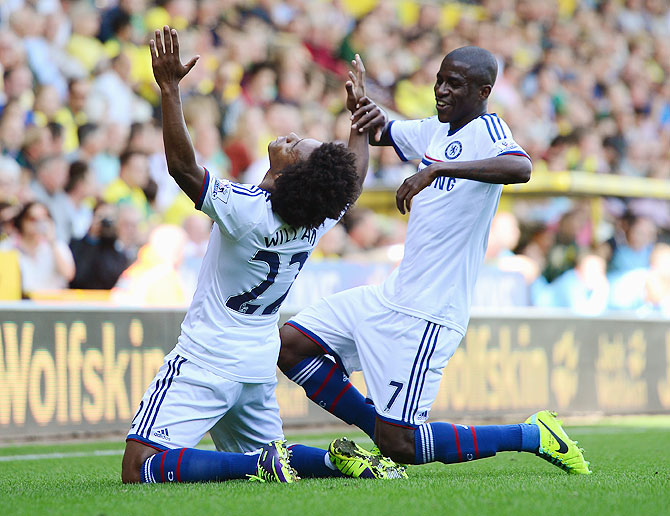 Chelsea's Willian celebrates with teammate Ramires after scoring against Norwich City during their English Premier League match at Carrow Road in Norwich on Sunday