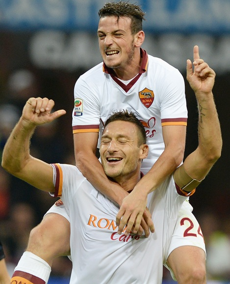 Francesco Totti of AS Roma (centre) celebrates his goal with teammate Alessandro Florenzi