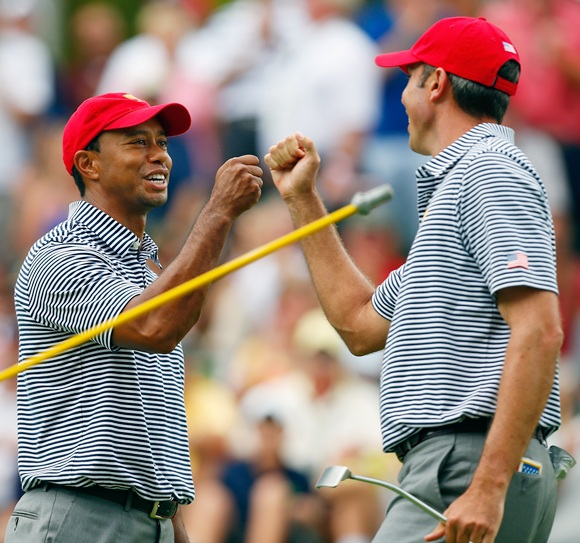 Tiger Woods (left) and Matt Kuchar of the US Team celebrate