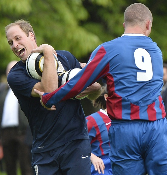Prince William, Duke of Cambridge trains with players in the   grounds of Buckingham Palace to mark the Football Association's 150th anniversary