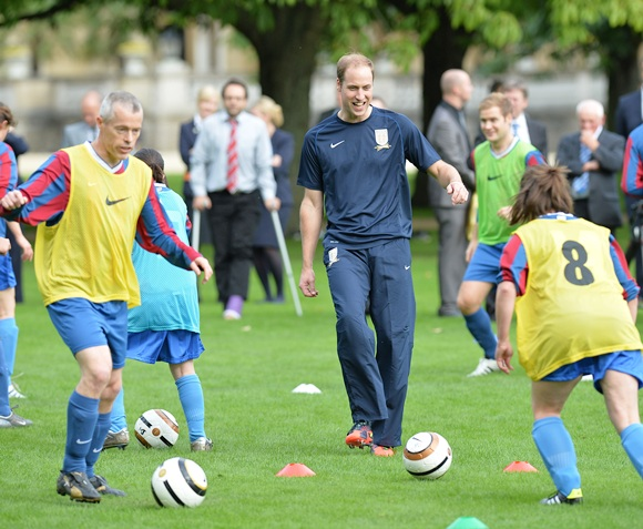Prince William, Duke of Cambridge trains with players in the grounds of Buckingham Palace