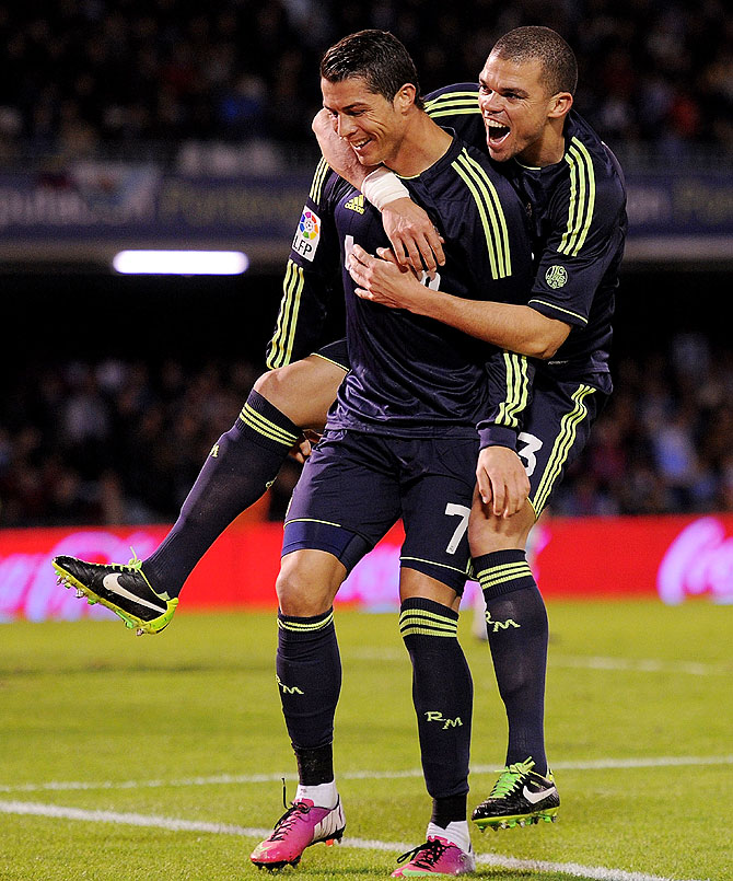 Cristiano Ronaldo (left) of Real Madrid celebrates with teammate Pepe