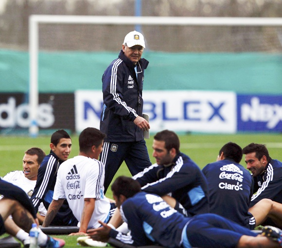 Argentina's head coach Alejandro Sabella (centre) walks past his players during a training session