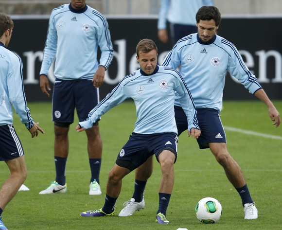 Germany's national soccer player Mats Hummels (right) tackles Mario Goetze during a training session