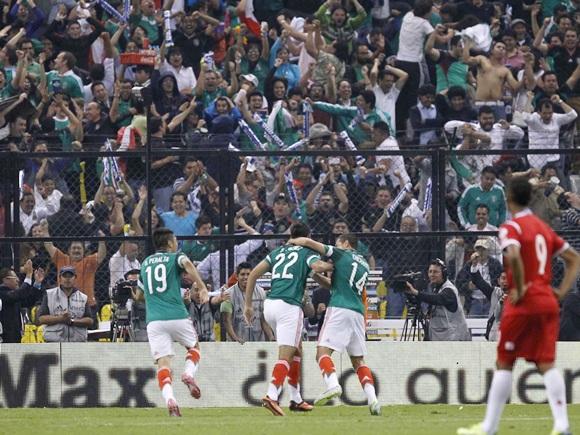 Mexico's Raul Jimenez (22) celebrates with team mates