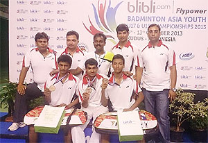 The winning Indian badminton team with their medals