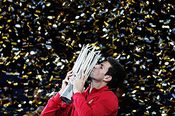 Novak Djokovic of Serbia poses with the winner's trophy after defeating Juan Martin Del Potro of Argentina during day seven of the Shanghai Masters