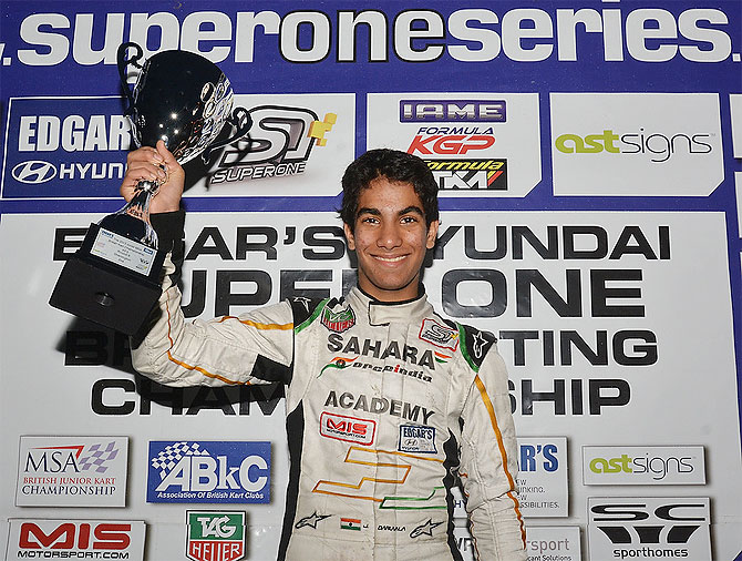 Sahara Force India Academy's Jehan Daruwala with the British Karting Championship trophy