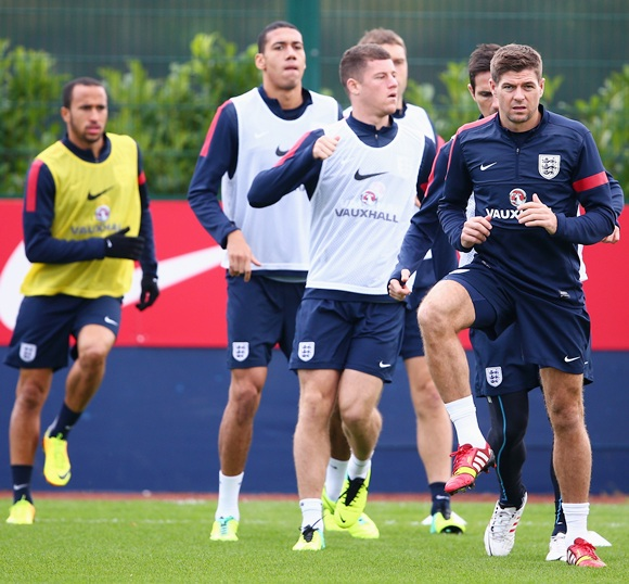 Steven Gerrard of England leads his team-mates during an England Training session