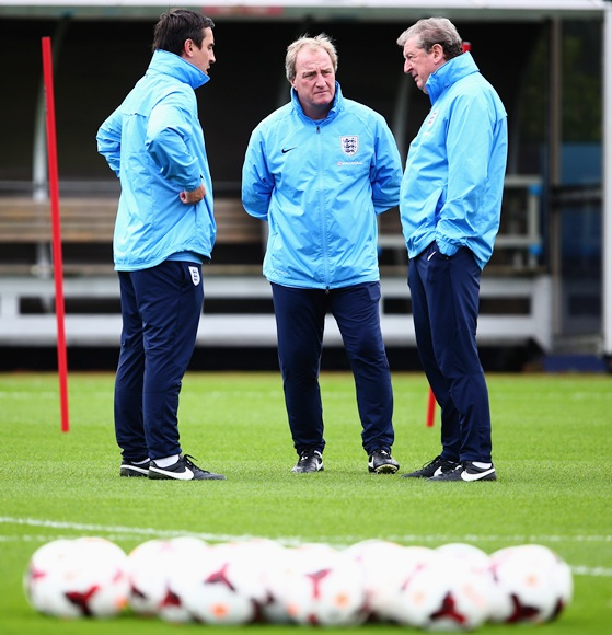England manager Roy Hodgson talks to coaches Gary Neville and Ray Lewington during an England Training session