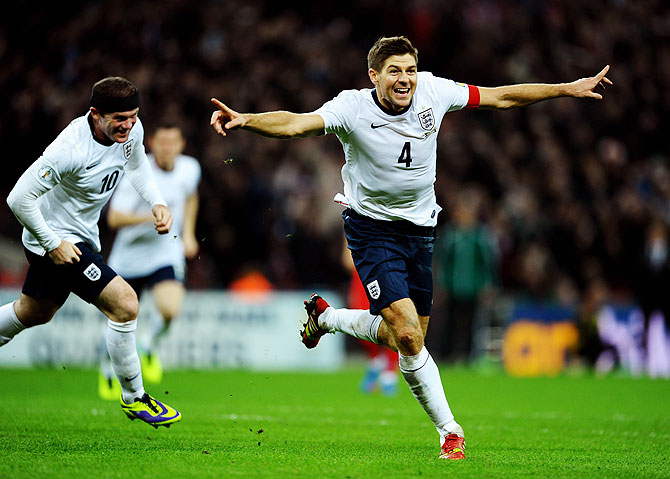 Steven Gerrard of England celebrates as he scores their second goal during the FIFA 2014 World Cup Qualifying Group H match against Poland at Wembley Stadium in London on Tuesday