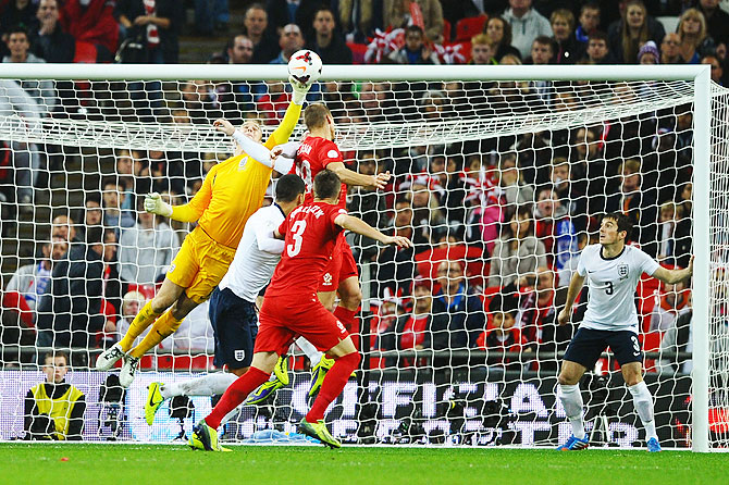 England goalkeeper Joe Hart makes a save during the FIFA 2014 World Cup Qualifying Group H match against Poland at Wembley Stadium in London on Wednesday