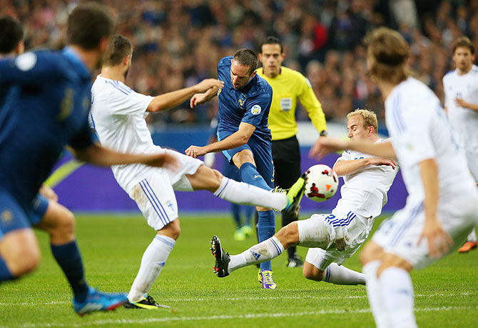 Franck Ribery of France shoots and scores the opening goal during the FIFA 2014 World Cup Qualifying Group I match against Finland at the Stade de France in Paris on Tuesday