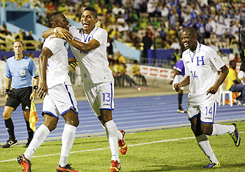 Honduras' Maynor Figueroa (left) celebrates with teammates Carlos Costly (centre) and Garcia Oscar after scoring the team's second goal against Jamaica