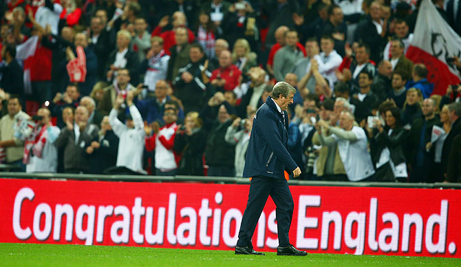 Roy Hodgson walks off the pitch after England beat Poland to qualify for the 2014 World Cup