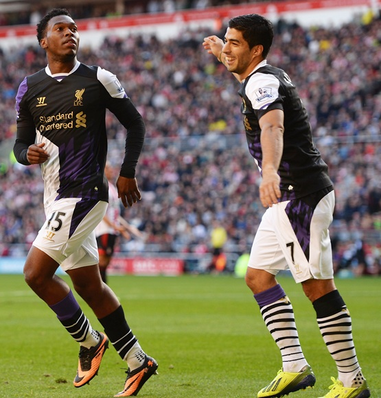 Daniel Sturridge (left) of Liverpool celebrates with Luis Suarez
