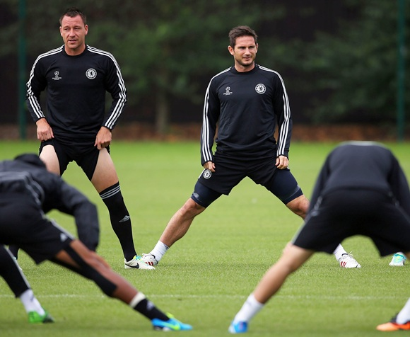 John Terry and Frank Lampard of Chelsea look on during a training session