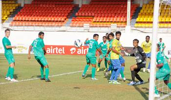 Action from the I-League match between Salgaocar (green jersey) and Mumbai FC