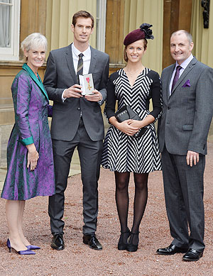 Wimbledon champion Andy Murray, his parents Judy and Will and his girlfriend Kim Sears pose at Buckingham Palace after being awarded the Order of the British Empire (OBE) from Prince William, Duke of Cambridge. on Thursday