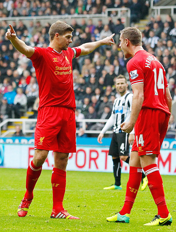 Image: Steven Gerrard (left) of Liverpool celebrates scoring his 100th Premier League goal with teammate Jordan Henderson during their English Premier League match against Newcastle United at St James' Park in Newcastle on Saturday