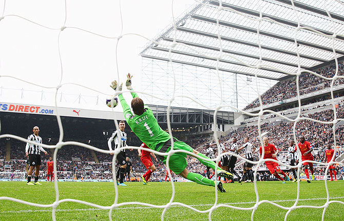 Tim Krul of Newcastle United makes a save to deny Luis Suarez of Liverpool in stoppage time during their English Premier League match at St James' Park in Newcastle on Saturday