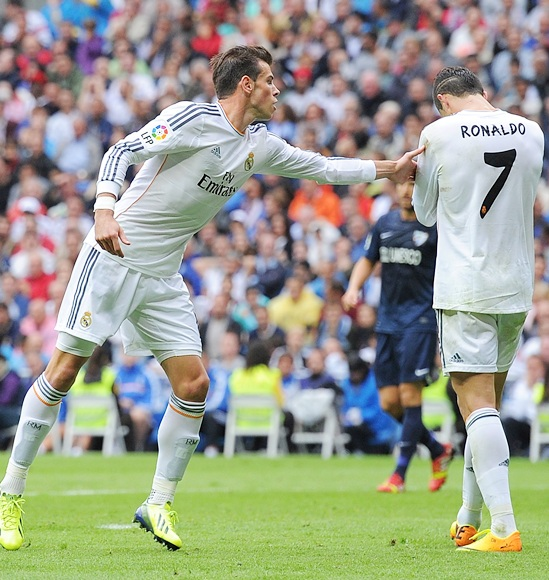 Gareth Bale (left) of Real Madrid CF encourages team-mate Cristiano Ronaldo