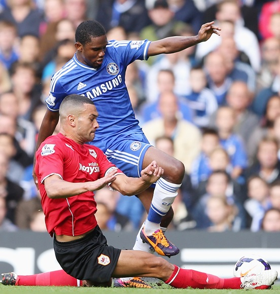 Samuel Eto'o of Chelsea is tackled by Steven Caulker of Cardiff