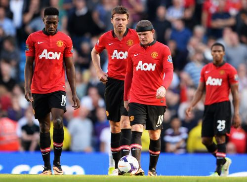 Manchester United players react after conceding a goal