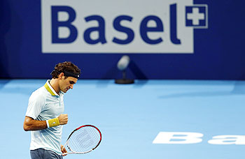 Switzerland's Roger Federer reacts during his match against Adrian Mannarino of France at the Swiss Indoors ATP tennis tournament in Basel