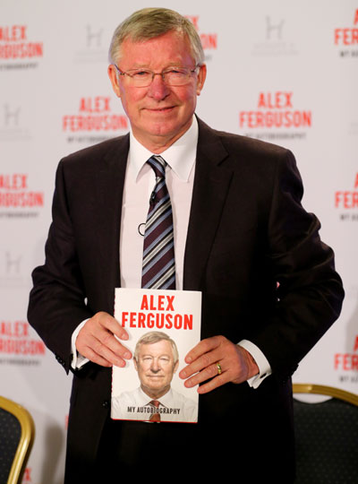 Sir Alex Ferguson poses during a press conference ahead of the publication of his auto