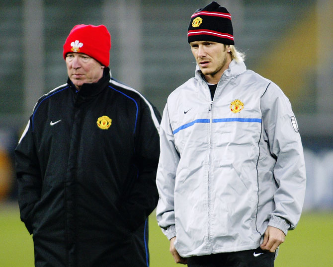 Manchester United Manager Sir Alex Ferguson talks with David Beckham during a training session