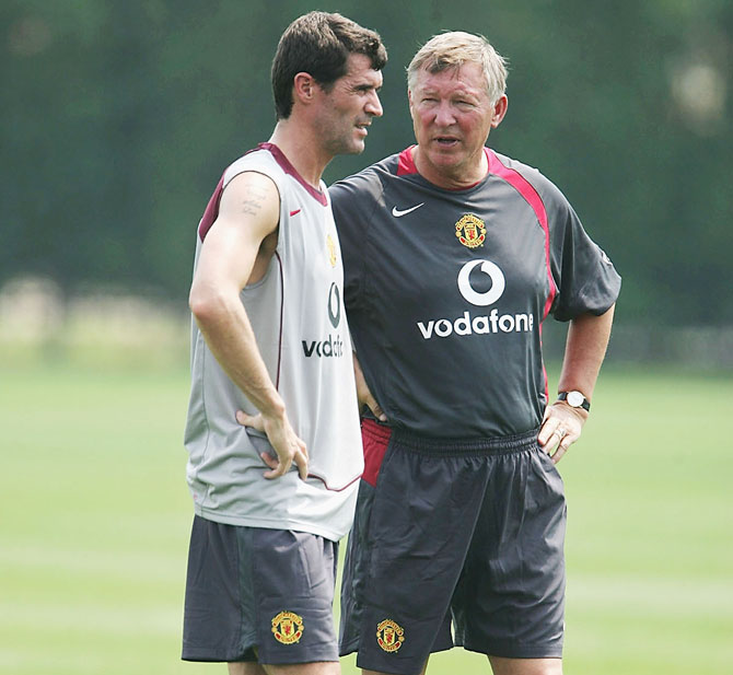 Footballer Roy Keane and Manager Sir Alex Ferguson stand together during a training session