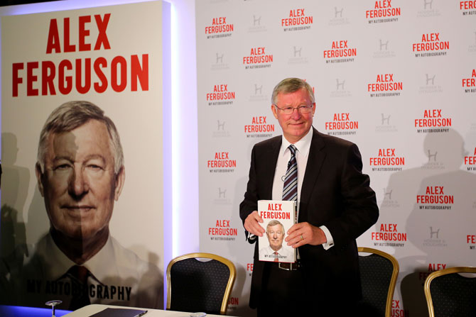 Sir Alex Ferguson poses during a press conference ahead of the publication of his autobiography