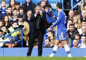 Chelsea's manager Jose Mourinho gestures as he speaks to Eden Hazard during their English Premier League soccer match against Cardiff City at Stamford Bridge in London, on Saturday