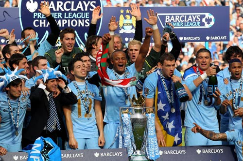 The Manchester City players celebrate with the Barclay's Premier League trophy