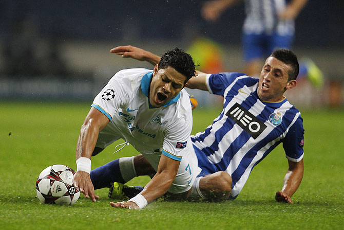Zenit St Petersburg's Hulk (left) is tackled by Porto's Hector Herrera during their Champions League match at Dragon stadium in Porto on Tuesday