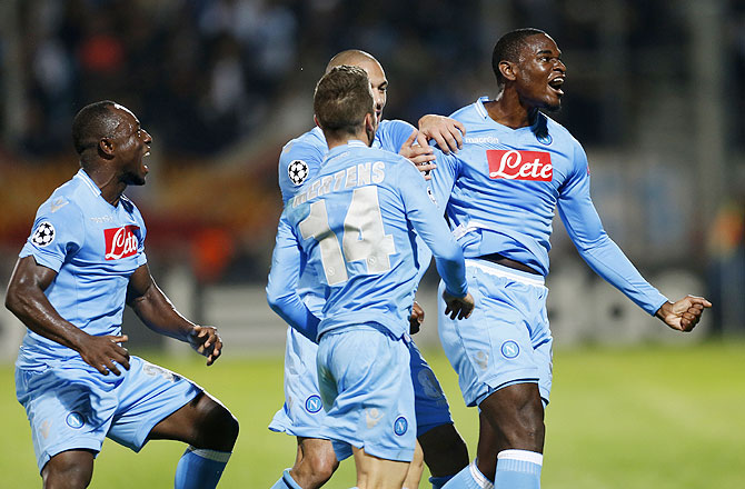 Napoli's Duvan Zapata (right) celebrates with teammates after scoring against Olympique Marseille during their Champions League soccer match at the Velodrome stadium in Marseille on Tuesday