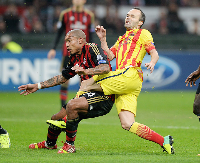 Nigel de Jong of AC Milan challenges Andres Iniesta of FC Barcelona during their UEFA Champions League Group H match at Stadio Giuseppe Meazza in Milan on Tuesday