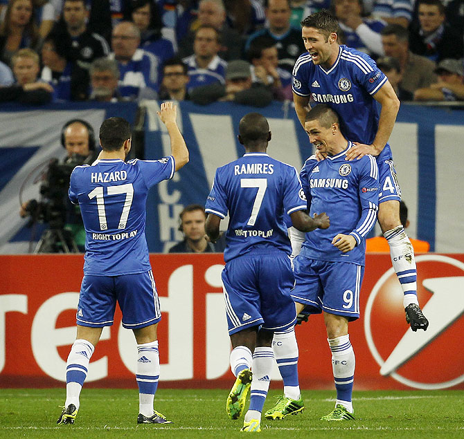 Chelsea's Fernando Torres (right) celebrates with teammates after scoring against Schalke 04 during their Champions League match in Gelsenkirchen, Germany, on Tuesday