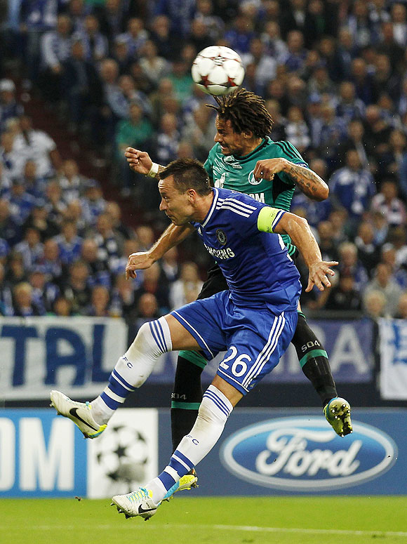 Chelsea's John Terry (left) and Schalke 04's Jermaine Jones vie for possession during their Champions League match in Gelsenkirchen, Germany on Tuesday