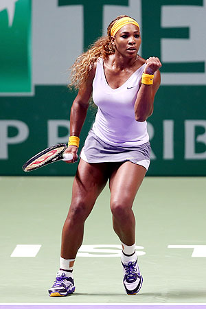 Serena Williams of the United States celebrates breaking Angelique Kerber of Germany during day one of the TEB BNP Paribas WTA Championships