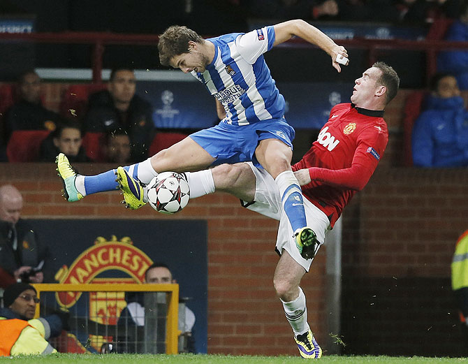 Manchester United's Wayne Rooney (right) challenges Real Sociedad's Inigo Martinez during their Champions League match at Old Trafford on Wednesday
