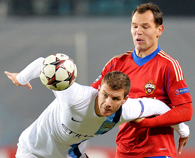 Sergei Ignashevich (right) of PFC CSKA Moscow in action against Edin Dzeko of Manchester City FC during the UEFA Champions League Group D match against PFC CSKA Moscow at the Arena Khimki Stadium in Khimki, Russia on Wednesday