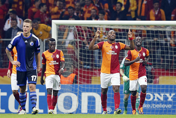 Didier Drogba of Galatasaray (2nd from right) celebrates his goal against FC Copenhagen during their Champions League soccer match in Istanbul on Wednesday