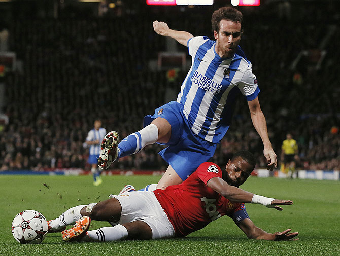 Manchester United's Patrice Evra (right) challenges Real Sociedad's Mikel Gonzalez during their Champions League match at Old Trafford on Wednesday