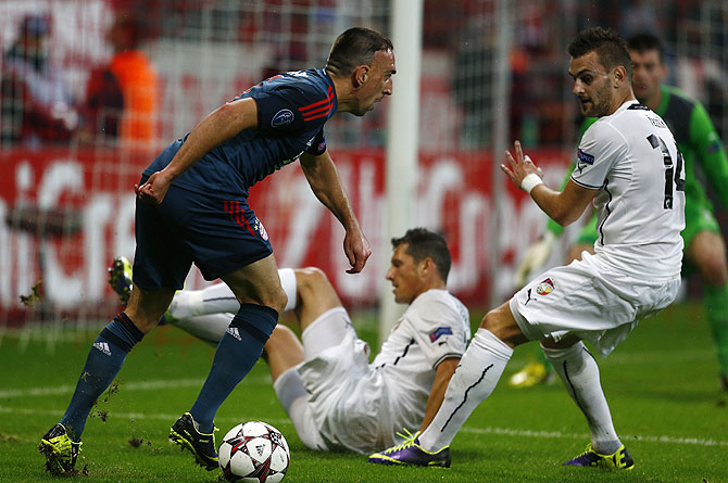 Bayern Munich's Franck Ribery (left) challenges Viktoria Plzen's Radim Reznik during their Champions League match in Munich on Wednesday