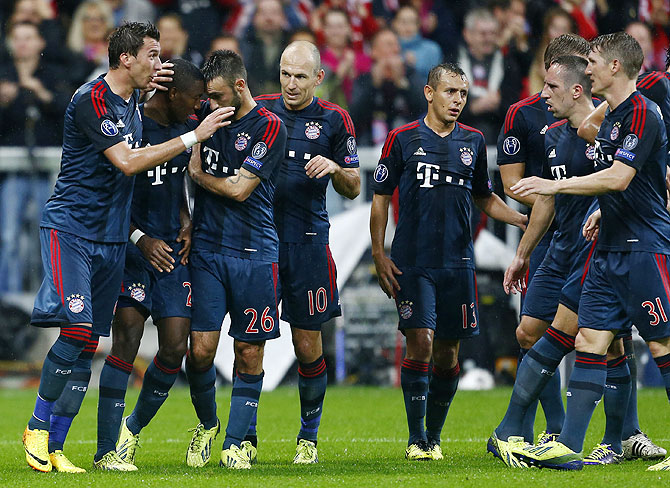 Bayern Munich's David Alaba (2nd from left) celebrates with his teammates after scoring a goal against Viktoria Plzen on Wednesday