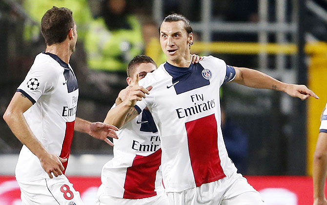 Paris Saint-Germain's Zlatan Ibrahimovic (right) celebrates after scoring against Anderlecht during their Champions League match at Constant Vanden Stock stadium in Brussels on Wednesday