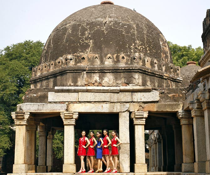 Formula One grid girls pose at the tomb of Firoz Shah in New Delhi